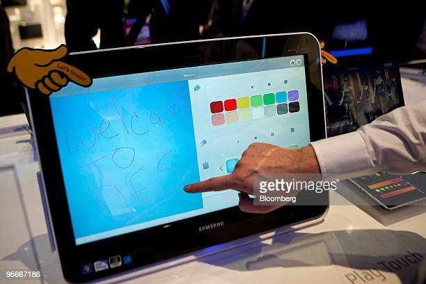 The touch functionality of Samsung Electronics Co's DMU200 touchscreen allinone computer is demonstrated by Dustin Serbin during the 2010...