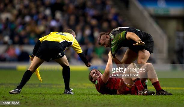 The touch judge steps in to break up a scirmish between Rhys Gill of Saracens and Joe Marler of Harlequins during the Aviva Premiership match between...