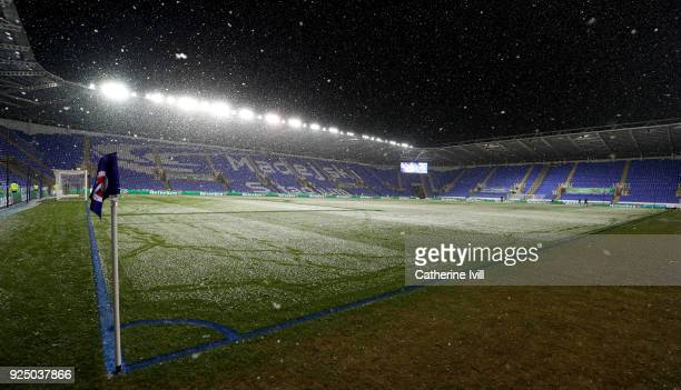 The touchlines are painted blue as snow falls ahead of the Sky Bet Championship match between Reading and Sheffield United at Madejski Stadium on...