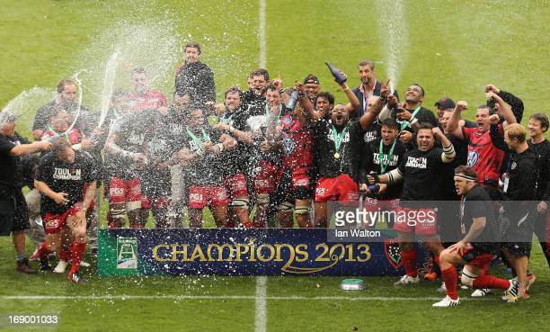 The Toulon players celebrate with the trophy at the end of the Heineken Cup final match between Clermont Auvergne and RC Toulon at the Aviva Stadium...