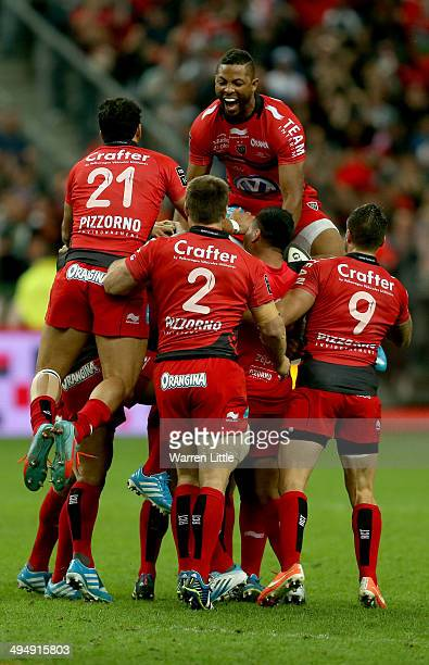 The Toulon team celebrate winning the Top 14 Final between Toulon and Castres Olympique at Stade de France on May 31 2014 in Paris France