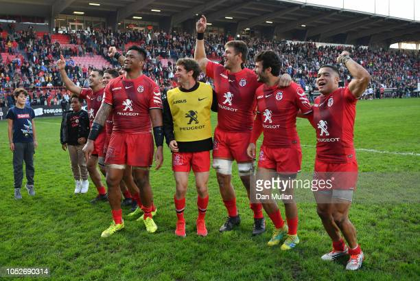 The Toulouse players celebrate following victory during the Champions Cup match between Toulouse and Leinster Rugby at Stade ErnestWallon on October...