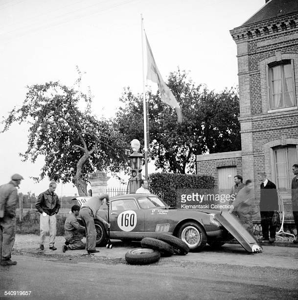The Tour de France Auto Charade Circuit September 1421 1958 A cange of tires for the Ferrari 250 Tour de France driven by Maurice Trintignant and...