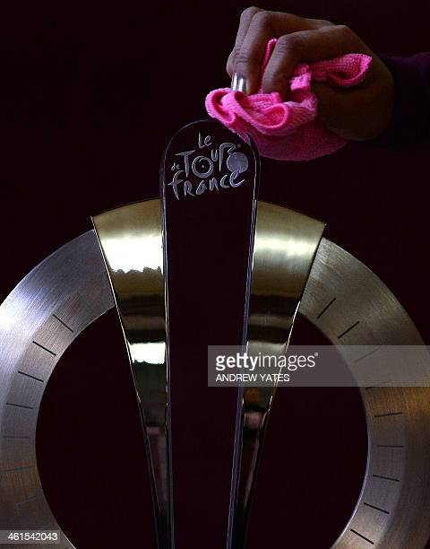 The Tour de France Grand Depart Trophy is readied for display at Leeds Civic Hall in Leeds northwest England on January 9 2014 The trophy was created...