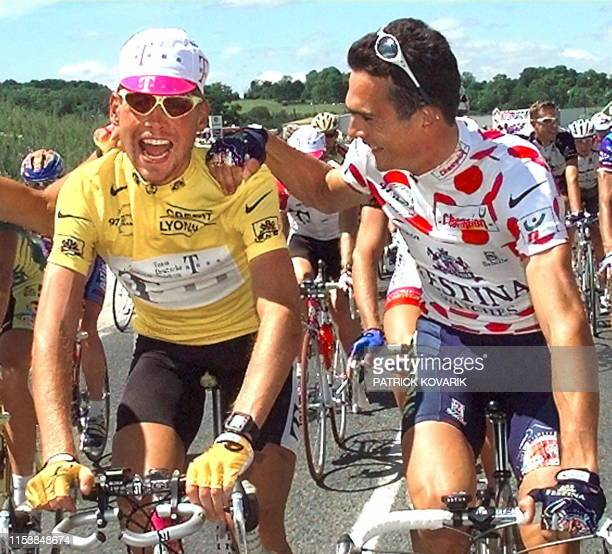 The Tour de France leader German Jan Ullrich wearing the yellow jersey jokes with the second placed in the overall rankings Frenchman Richard...