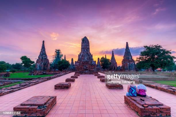 the tourisms are in wat chaiwatthanaram buddhist temple in the city of ayutthaya historical park at ayutthaya,thailand. - sukhothai stockfoto's en -beelden
