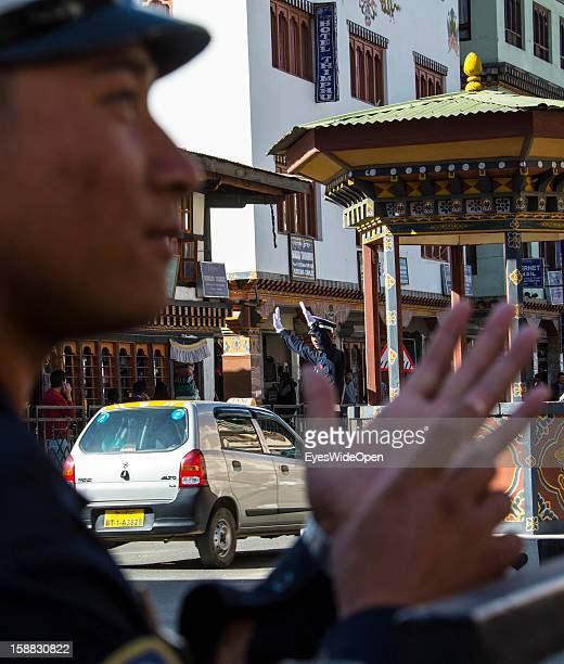 The tourist attraction when a Police officer directs traffic at the central road junction with special gestics on November 18 2012 in Thimphu Bhutan...