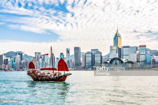 the tourist duk ling traditional chinese sightseeing junk ship in victoria harbour, hong kong - hong kong stock pictures, royalty-free photos & images