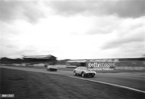 The Tourist Trophy Goodwood August 20 1960 Lights ablaze in the late afternoon the Ferrari 250GT of Graham Whitehead swings into Fordwater