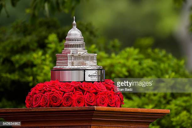 The tournament trophy sits on display on the first hole tee box during the first round of the Quicken Loans National at Congressional Country Club on...