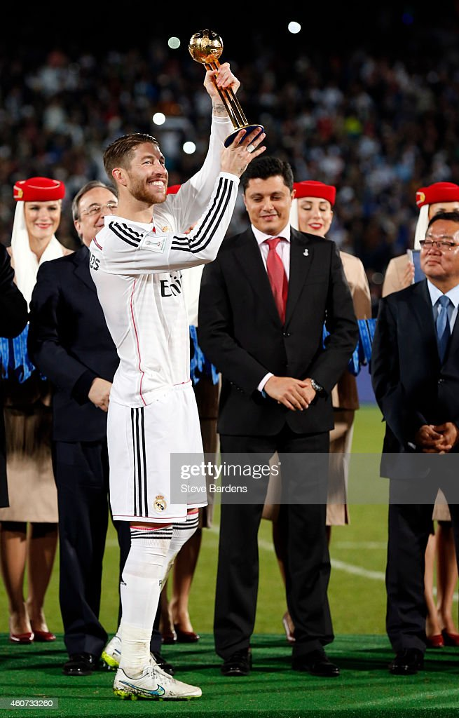 The tournament's MVP Sergio Ramos of Real Madrid CF celebrates with his trophy during a presentation ceremony after the FIFA Club World Cup Final match between Real Madrid CF and San Lorenzo at Le Grand Stade de Marrakech on December 20, 2014 in Marrakech, Morocco.