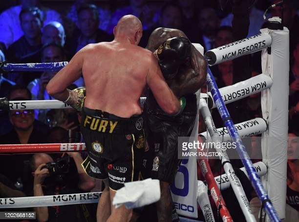 The towel is thrown in by Wilder's trainer as British boxer Tyson Fury defeats US boxer Deontay Wilder in the seventh round during their World Boxing...