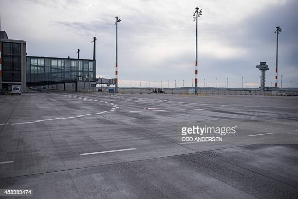 The tower and terminal building of the not yet opened Berlin Brandenburg Airport in Schoenefeld on November 4 2014 AFP PHOTO / ODD ANDERSEN