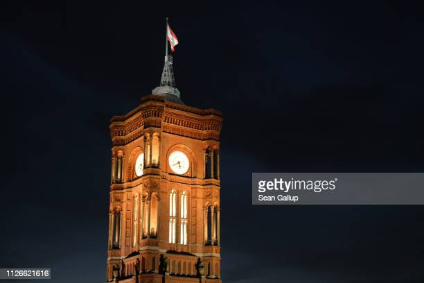 The tower at Berlin's City Hall stands illuminated during twilight on January 29 2019 in Berlin Germany The building is called Rotes Rathaus or red...