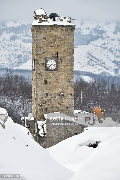 The tower clock is seen in a central street of the damaged central Italian village of Amatrice, after a 5.7-magnitude earthquake struck the region,...