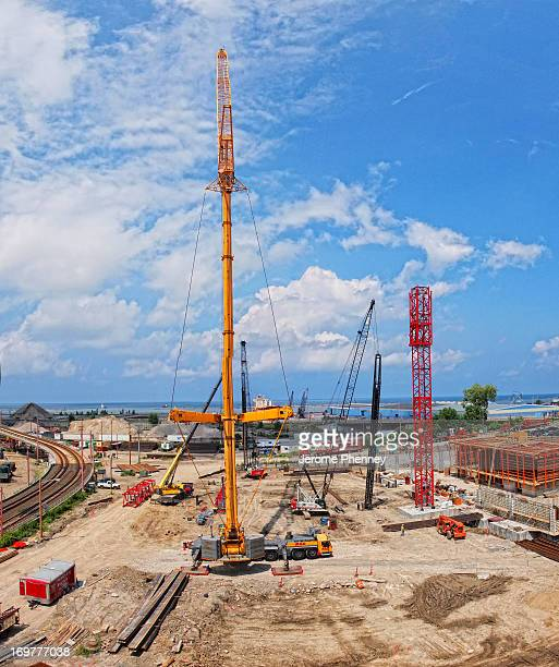 CONTENT] The tower crane being assembled for the East Bank Flats Office Tower Project