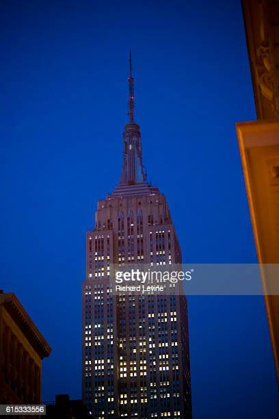 The tower lights of the iconic Empire State Building in New York are dark on Tuesday, March 22, 2016 in memoriam of the victims of the terrorist...