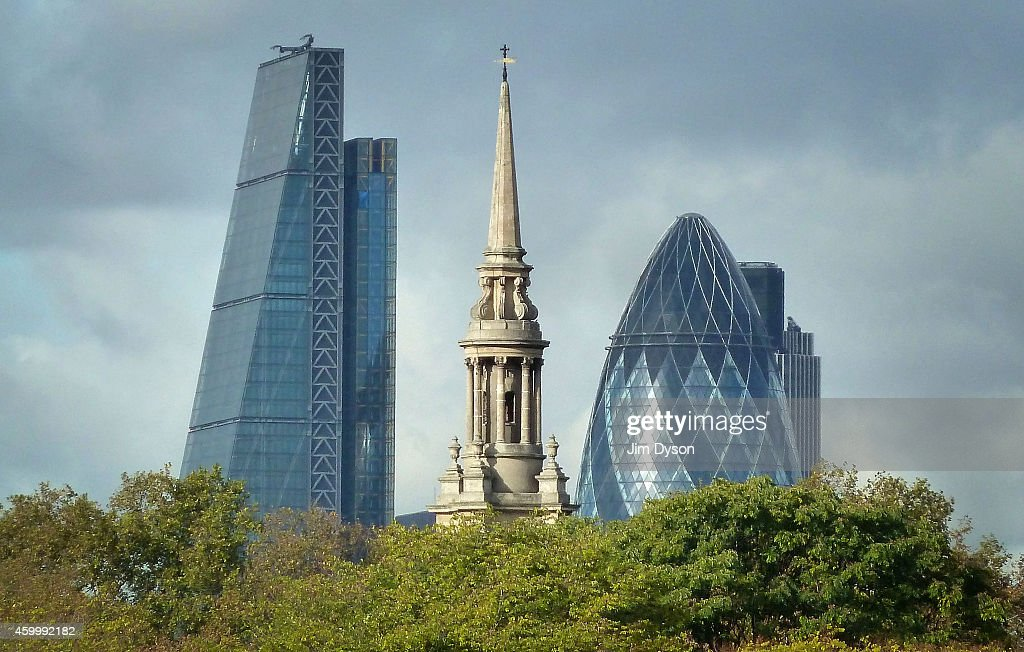 The tower of 122 Leadenhall Street, also known as the Cheesegrater, stands beside 30 St Mary Axe, also known as The Gherkin, in the City of London on the River Thames on October 20, 2014 in London, England.