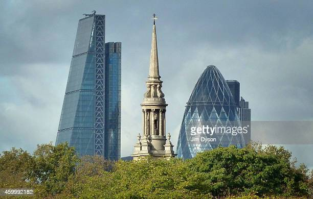 The tower of 122 Leadenhall Street also known as the Cheesegrater stands beside 30 St Mary Axe also known as The Gherkin in the City of London on the...