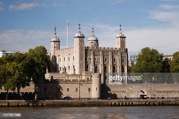 The Tower of London, a former prison turned tourist attraction and UNESCO World Heritage Site, stands beside the River Thames in London, England, on...