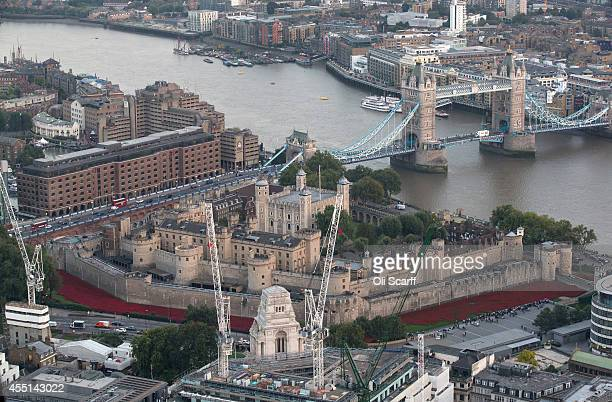 The Tower of London surrounded by an installation entitled 'Blood Swept Lands and Seas of Red' by artist Paul Cummins of 888246 ceramic poppies is...
