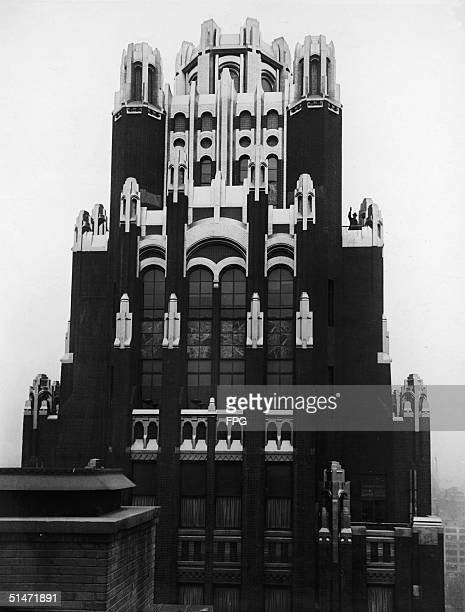 The tower of the American Radiator Building now the Bryant Park Hotel as it appears during daylight New York mid 1930s The building was specially...