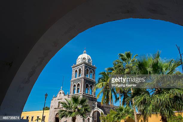 The tower of the Jesuit Mission built in 1697 with palm trees in the foreground in Loreto in Baja California Mexico