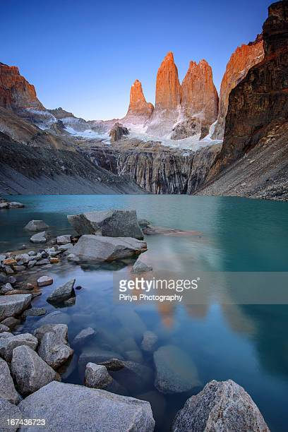 the towers alpenglow - torres del paine national park stock photos and pictures