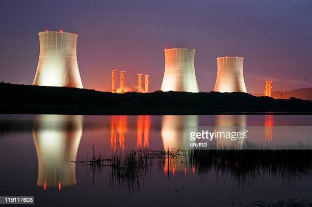 The towers of a power station lit up at night
