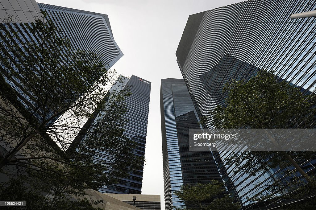 The towers of the Marina Bay Financial Centre stand in the central business district in Singapore, on Saturday, Dec. 29, 2012. Singapore may grapple with elevated inflationary pressures for a third year in 2013, reducing scope for the central bank to provide stimulus to an economy that probably entered a technical recession this quarter. Photographer: Munshi Ahmed/Bloomberg via Getty Images