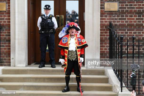 The town crier announces the birth of Catherine's Duchess of Cambridge and Prince William's Duke of Cambridge son outside the Lindo Wing at St Mary's...