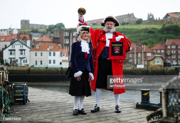The town crier of Scarborough David Birdsall and his consort Veronica Dickinson pose for a picture as they prepare to lead a civic parade to...