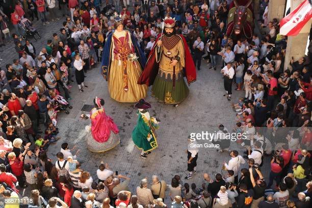 The town giants dance on the main square to a gathered crowd prior to a competition of human towers teams at the St Ursula festival on October 22...