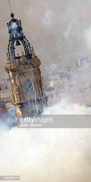 """The Town Hall of Valencia is engulfed by firecrackers smoke at 2 o'clock in the afternoon on March 2, 2012 after the shot of the second """"mascleta""""..."""