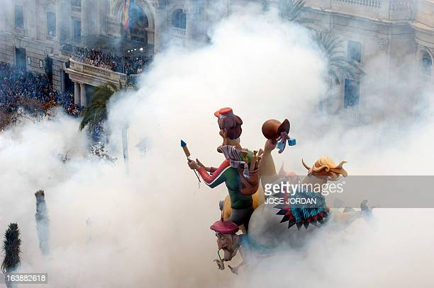 The Town Hall of Valencia is engulfed by firecrackers smoke at 2 o'clock in the afternoon on March17 after the shot of the 17th mascleta celebrating...