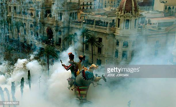 The Town Hall of Valencia is engulfed by firecrackers smoke on March 17 after the shot of the 17th mascleta celebrating the arrival of spring AFP...