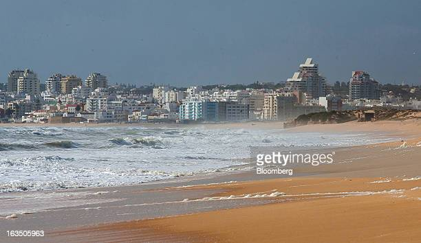 The town of Armacao de Pera stands on the Atlantic coast near a beach seen from the closed Herdade dos Salgados Resort of luxury apartments operated...