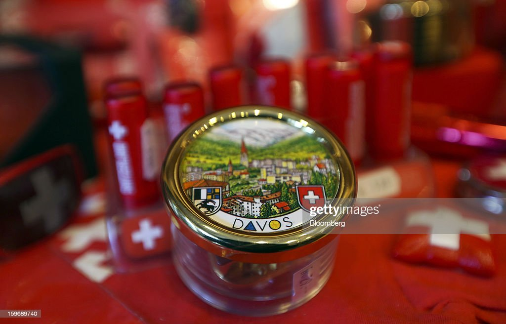 The town of Davos is depicted on the lid of a souvenir displayed for sale inside a tourist store in Davos, Switzerland, on Friday, Jan. 18, 2013. Next week the business elite gather in the Swiss Alps for the 43rd annual meeting of the World Economic Forum in Davos, the five day event runs from Jan. 23-27. Photographer: Chris Ratcliffe/Bloomberg via Getty Images