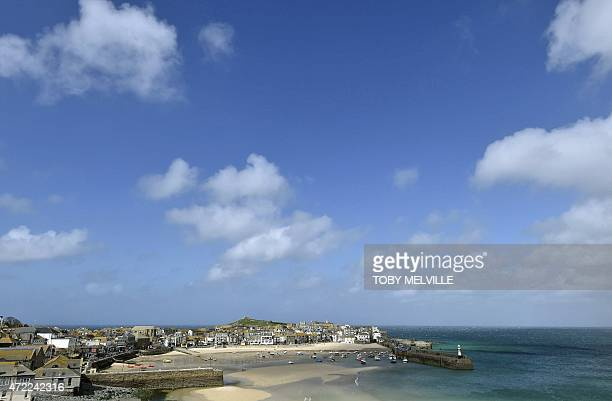 The town of St Ives in Cornwall southwest England is seen as Britain's Prime Minister David Cameron speaks at an election rally on May 5 2015...