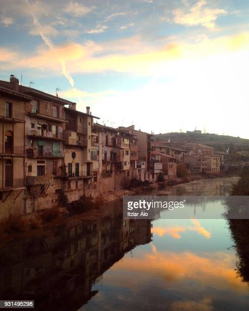 The town of Valderobres reflected in Matarraña River at Sunset. Teruel , provincial of Aragón, Spain