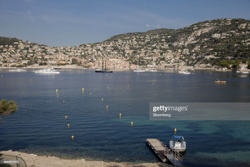 The town of Villefrance-sur-Mer sits across the water from the private beach of the Villa Les Cedres, a 187-year-old, 18,000-square-foot, 14-bedroom mansion set on 35 acres, in Saint-Jean-Cap-Ferrat, France, on Tuesday, Sept. 26, 2017. With a list price of 350 million ($410 million), the owner, the Italian distiller Davide Campari-Milano SpA, is betting that the houses combination of history, luxury, and a prime location along the coast of Saint-Jean-Cap-Ferrat will be enough to make it the most expensive residential sale in history. Photographer: Marlene Awaad/Bloomberg via Getty Images
