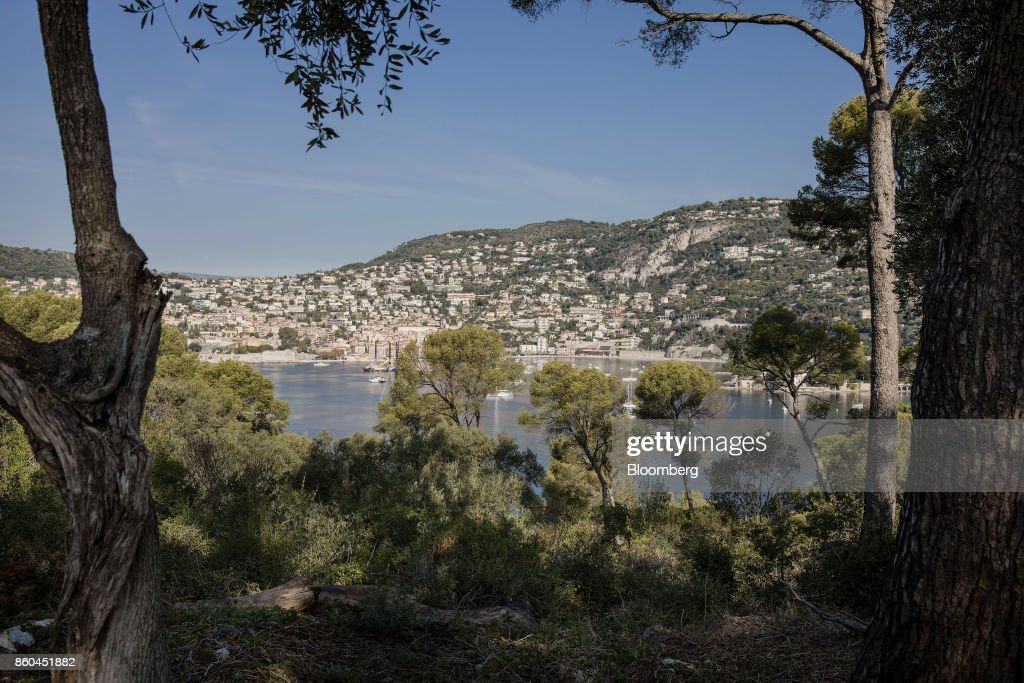 The town of Villefrance-sur-Mer sits on the coast beyond the private gardens of the Villa Les Cedres, a 187-year-old, 18,000-square-foot, 14-bedroom mansion set on 35 acres, in Saint-Jean-Cap-Ferrat, France, on Tuesday, Sept. 26, 2017. With a list price of 350 million ($410 million), the owner, the Italian distiller Davide Campari-Milano SpA, is betting that the houses combination of history, luxury, and a prime location along the coast of Saint-Jean-Cap-Ferrat will be enough to make it the most expensive residential sale in history. Photographer: Marlene Awaad/Bloomberg via Getty Images