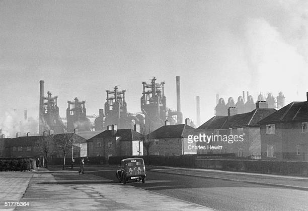 The town's steelworks looms over suburban a street in Corby Northamptonshire 11th February 1950 Original publication Picture Post 4975 Did You Know...
