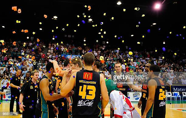 The Townsville Crocodiles celebrate after winning the round 14 NBL match between the Townsville Crocodiles and the Perth Wildcats at Townsville...