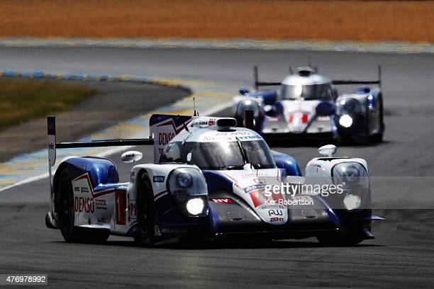 The Toyota TS 040Hybrid of Anthony Davidson Sebastien Buemi and Kazuki Nakajima drives during the Le Mans 24 Hour race at the Circuit de la Sarthe on...