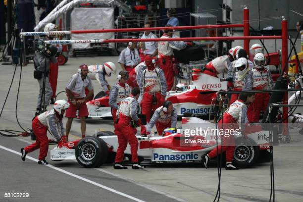 The Toyota F1 team withdraw their cars after the start of the United States F1 Grand Prix at the Indianapolis Motor Speedway on June 19, 2005 in...
