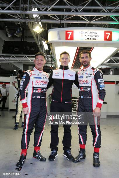 The Toyota Gazoo Racing drivers Kamui Kobayashi, Mike Conway, and Jose Maria Lopez celebrate pole position before being demoted to the back of the...