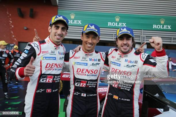 The Toyota Gazoo Racing drivers Sebastien Buemi, Kazuki Nakajima, and Fernando Alonso, celebrate victory in parc ferme at the WEC 6 Hours Of...