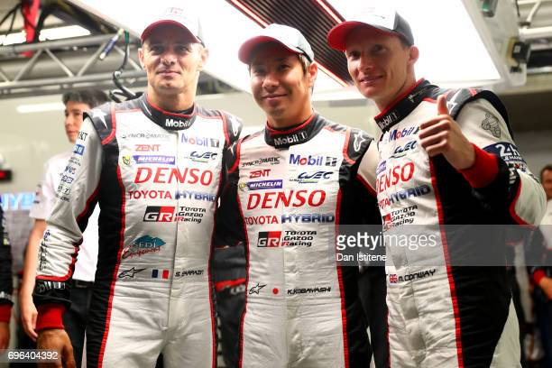 The Toyota Gazoo Racing TS050 drivers Stephane Sarrazin, Kamui Kobayashi and Mike Conway celebrate in the garage after claiming pole position during...