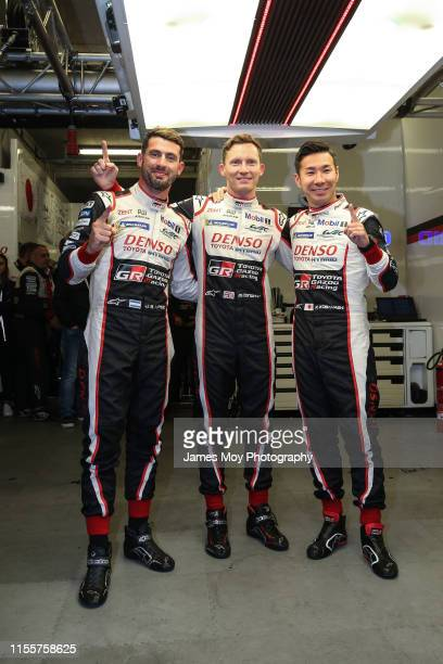 The Toyota Gazoo Racing TS050 Hybrid number 7 drivers Jose Maria Lopez Mike Conway and Kamui Kobayashi celebrate taking pole position during...